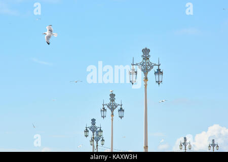 Traditional street lamp design in Brighton's seaside promenade. - Stock Image
