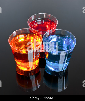 Three shots on a black background perfect for promotions or offer in the alcoholic drinks industry - Stock Image