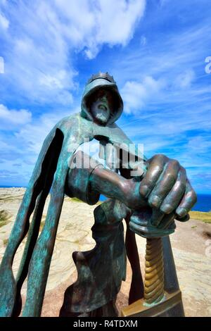 King Arthur an 8 ft bronze sculpture by artist Rubin Eynon, named Gallos Cornish word for Power, Tintagel castle Island Peninsular,Cornwall,England,UK - Stock Image