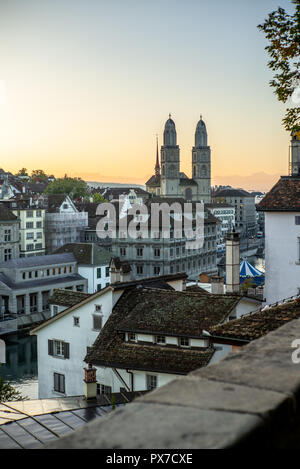 Sunrise on the Zurich cathedral and the Limmat river in Autumn - Stock Image