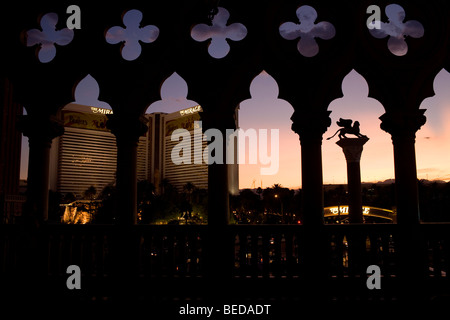 A view of the Mirage Hotel and Casino from the Venetian Hotel and Casino at sunset in Las Vegas, Nev., U.S.A. - Stock Image