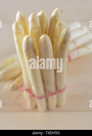 New harvest of white asparagus, two bunches high quality raw asparagus in spring season, ready to cook close up - Stock Image