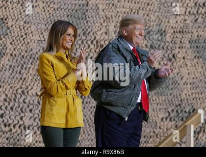 U.S. President Donald Trump and First Lady Melania Trump address remarks to service members during a surprise visit to Al Asad Air Base December 26, 2018 in Al Anbar, Iraq. The president and the first lady spent about three hours on Boxing Day at Al Asad, located in western Iraq, their first trip to visit troops overseas since taking office. - Stock Image