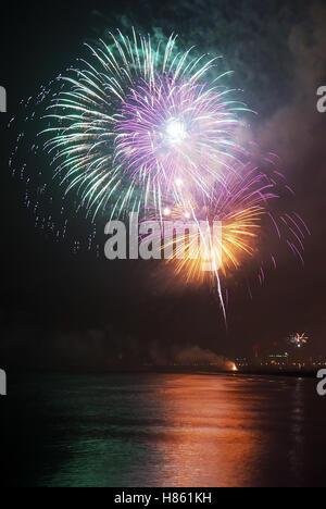 Night firework on the sea in summer in Rimini,Italy - Stock Image