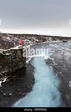 Bruarfoss waterfall, Brekkuskógur, Iceland. A man admires the landscape - Stock Image