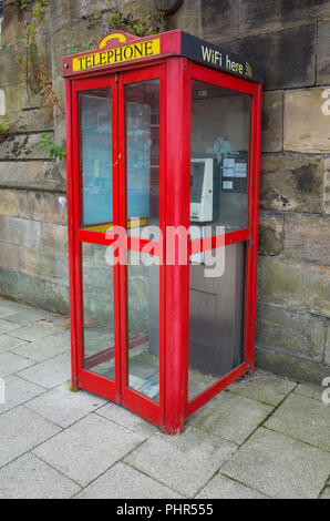 New World payphones red box providing telephone and WiFi services on cash or credit payment - Stock Image