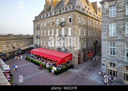 Looking down on cafes inside the walls at St Malo, Brittany, France - Stock Image