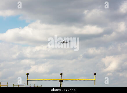 Passenger airplane approaching landing lights - Stock Image
