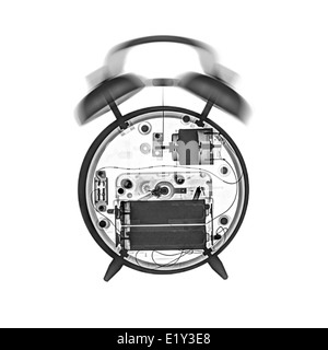X-ray of a ringing mechanical alarm clock - Stock Image