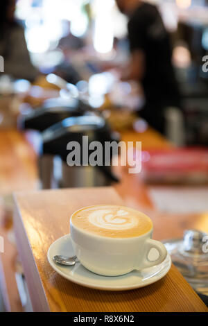 Cafe Latte at Coffee Shop with Great Foam from a Talented Barist - Stock Image