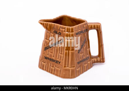 An old water jug advertising Old Bushmills Irish Whiskey, the world's oldest whiskey - Stock Image