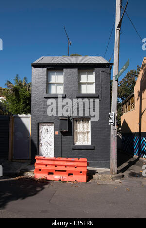 A narrow street corner with a single stand alone double story terrace house in Surry Hills, Sydney Australia - Stock Image
