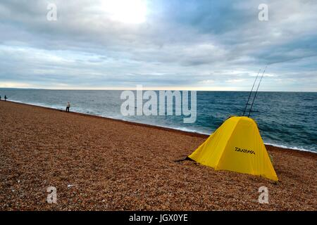 Chesil Beach, Dorset, UK. 10th July, 2017. UK Weather. Glorious weather attracted dozens of people to Chesil beach - Stock Image
