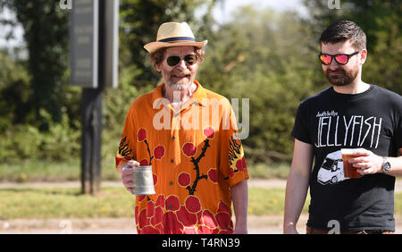 Crawley Sussex, UK. 19th Apr, 2019. Time for a beer in the sunshine at the World Marbles Championship held at The Greyhound pub at Tinsley Green near Crawley in Sussex . The annual event has been held on Good Friday every year since the 1930s and is open to players from around the world Credit: Simon Dack/Alamy Live News - Stock Image