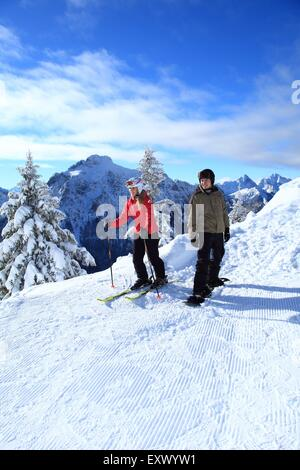 Female skier and snowboarder, Tegelberg, Ammergau Alps, Allgaeu, Bavaria, Germany, Europe - Stock Image