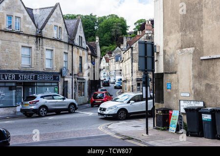 Traffic queued and passing up and down Market Street in Bradford on Avon seen from Silver street - Stock Image