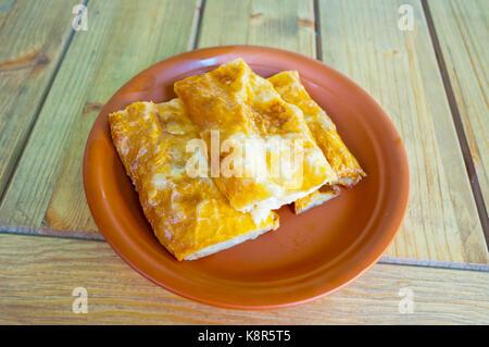 Moldavian layer pie with sheep cheese, La Placinte restaurant, Bucharest, Romania - Stock Image