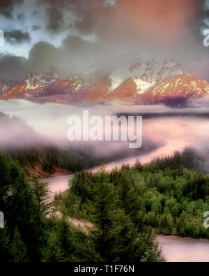 Snake River and Teton Mountains with storm clouds and morning light. Teton National Park, Wyoming. - Stock Image
