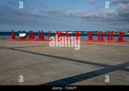 A red sign reading 'I love Equatorial Guinea' on the shore of Malabo, the capital of Equatorial Guinea, on the tropical island of Bioko - Stock Image