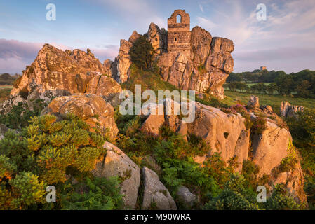 The ruins of St Michael's Chapel on Roche Rock in the Cornish village of Roche, Cornwall, England. Summer (July) 2017. - Stock Image