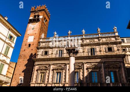 Palazzo Maffei against a dark blue sky in Piazza delle Erbe in Verona, Italy - Stock Image