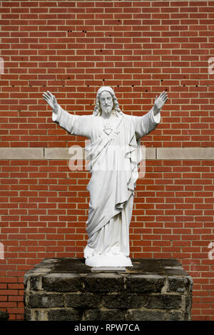 Statue of Jesus Christ, a christian religious figure, with open arms in front of a Catholic Church in Montgomery Alabama, USA. - Stock Image