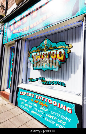 Tattoo shop window tattoo sign tattooing shop window signs tattooist shop sign UK England  tattooing sign - Stock Image