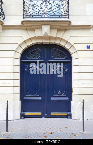 PARIS, FRANCE - JULY 22, 2017: Blue wooden closed door in Paris, Givenchy building in France - Stock Image
