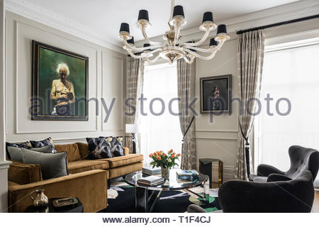 Painting of senior man in masculine living room - Stock Image