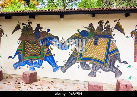 Exhibit of a Shekhavati painting with two nobles on caparisoned elephants engaging in battle in the National Crafts Museum, New Delhi, India - Stock Image
