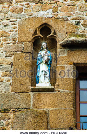 Views & sites around the town and Island of Mont St Michel on a cloudy day in Normandy, France. Statue, The - Stock Image