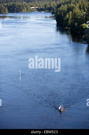 Man rowing a rowboat at  the river Leppävirta , Finland - Stock Image