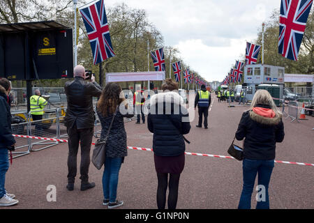 People photographing the preparations at the finish for the 2016 London Marathon - Stock Image