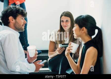 Business people discussing in office - Stock Image