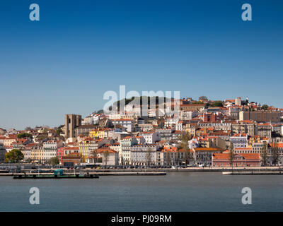 Portugal, Lisbon, city centre skyline and warterfront buildings of Alfama, Old Town from Tagus River - Stock Image