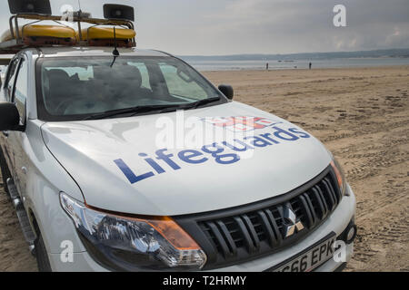 RNLI Lifeguards vehicle on beach, Cornwall, England, UK - Stock Image