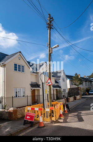 Work to replace telegraph telephone poles masts in Mill Street, Sidmouth, Devon, UK - Stock Image