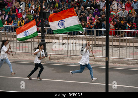 Patriotic Indian women attend the Attari-Wagah border closing the day after the Jaish-e-Mohammed terrorist attack in Indian-administered Kashmir. - Stock Image