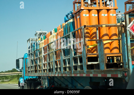 Truck carrying liquid gas cylinders - Stock Image