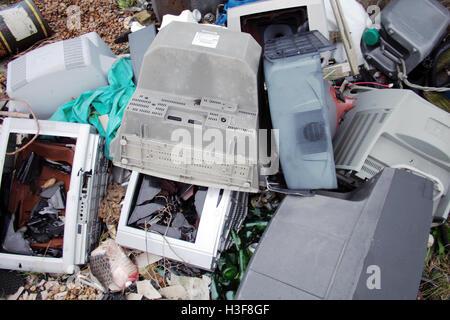 old abandoned broken Television sets - Stock Image
