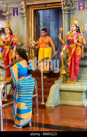 Hindu Priest Emerging from Inner Shrine, Sri Mahamariamman Hindu Temple, Kuala Lumpur, Malaysia. - Stock Image