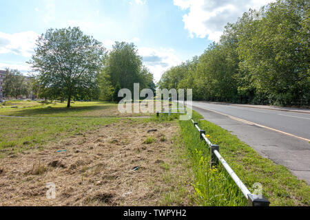 An open green space between the A4 Bath Road and flats on Grenville Road in Reading, Berkshire, UK - Stock Image