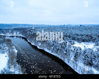 Vilnius, Lithuania: aerial top view of Neris river and Vingis park in winter - Stock Image