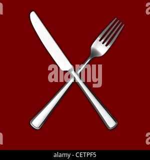 A still life shot of a knife and fork crossed on a red background (any colour background available on request) - Stock Image