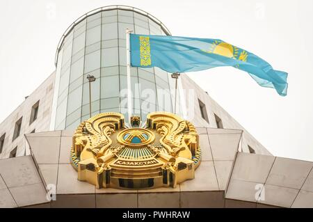 ASTANA, KAZAKHSTAN. October 12, 2018. Flag of Kazakhstan and coat of arms at the gate of Kazakhstan Senate in Astana. Kazakhstan Independence Day. - Stock Image