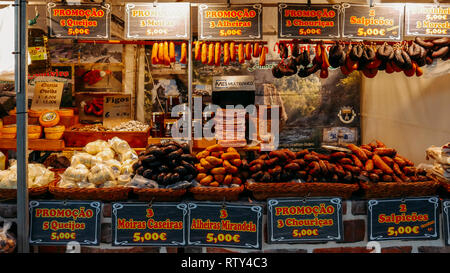 Caparica, Portugal - March 3, 2019: Typical cured Portuguese sausages known as Alheira hanging at a market stall in Portugal - Stock Image