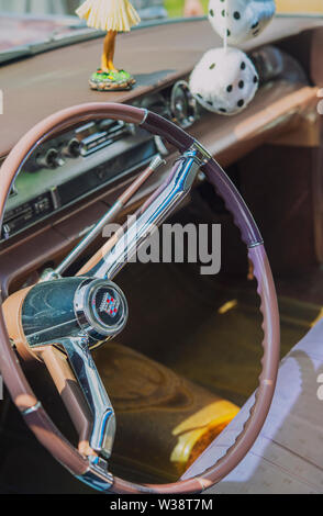 Steering wheel and interior of a vintage American Cadillac car - Stock Image
