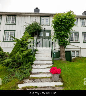 A white painted wooden house in Andalsnes, Norway - Stock Image