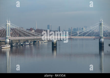 A view of Albert Bridge on a calm, sunny day - Stock Image