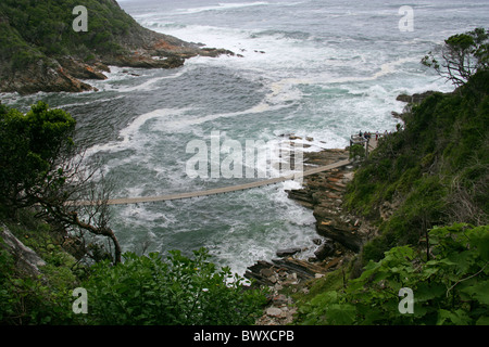 Suspension Bridge at Storms River Mouth, Tsitsikamma Nature Reserve, South Africa. - Stock Image